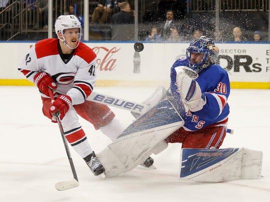 New York Rangers goalie Henrik Lundqvist (30) slides out of the crease to head off an attack by Carolina Hurricanes left wing Joakim Nordstrom (42) during the first period of an NHL hockey game, Tuesday, Nov. 29, 2016, in New York. (AP Photo/Julie Jacobson)