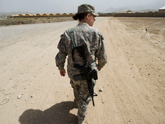 Vermont Guard Sgt. Whitney Hughes, 26, of Barre escorts the Free Press into Forward Operating Base Gardez on Monday, September 13, 2010.