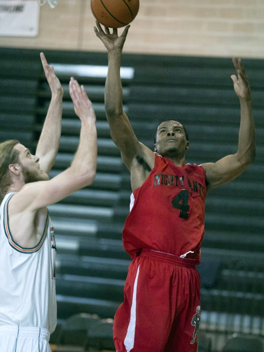 York's Kelvin Parker shoots over Harrisburg's Cory Boone in April during the Eastern Basketball Alliance championship. Harrisburg Horizon defeated the York Mighty Ants, 93-85.