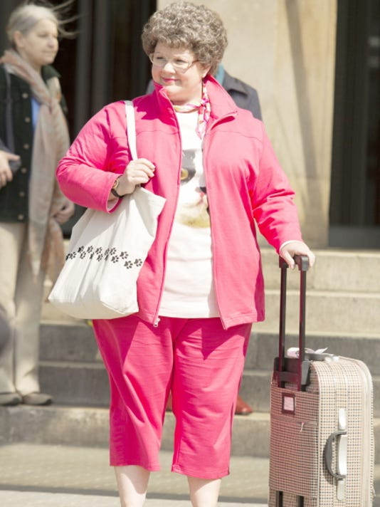 """This photo provided by Twentieth Century Fox shows, Melissa McCarthy, as Susan Cooper, a CIA analyst, who volunteers to go deep undercover to infiltrate the world of a deadly arms dealer, and prevent a global disaster, in a scene from the film, """"Spy."""""""
