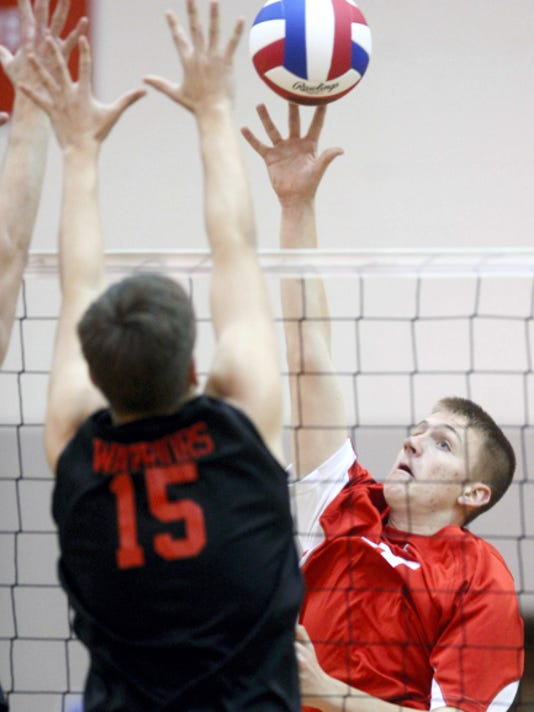 Dover's Hunter Shank hits against the defense of Susquehannock's Nick Voltaggio during a boys' volleyball match at Susquehannock High School on March 31.