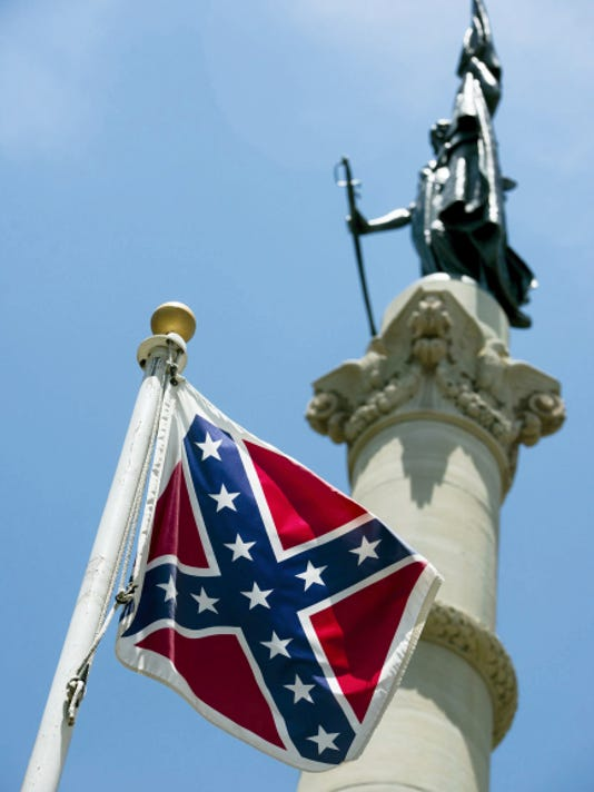 A Confederate flag flies next to the Alabama Confederate Memorial on the grounds of the Alabama Capitol building in Montgomery, Ala., June 22.