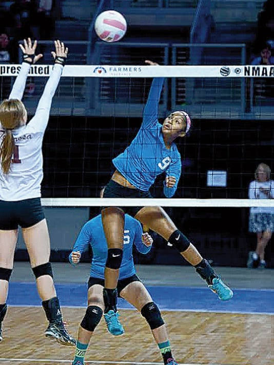 Navajo Prep's LeShauntai Adams spikes the ball during the Lady Eagles' quarterfinal match against Tularosa at the 3A state volleyball tournament Nov. 14, 2014, in Rio Rancho.