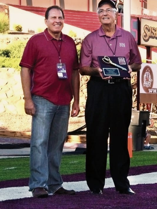 Royal Jones, left, with NMSU President Garry Curruthers, will receive an honorary doctorate degree during the spring 2015 commencement ceremony on May 9. The Las Cruces business man has generously given to major NMSU projects, such as Pan American Center seating and the renovation of the Coca-Cola Weight Training Center. (NMSU Photo)þÄã MAR15