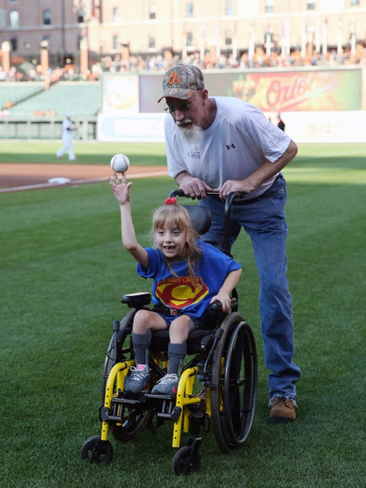 Landyn Grove threw out the ceremonial first pitch Monday night with her father, Dave Grove, prior to the Texas Rangers vs. Baltimore Orioles game at Camden Yards in Baltimore.