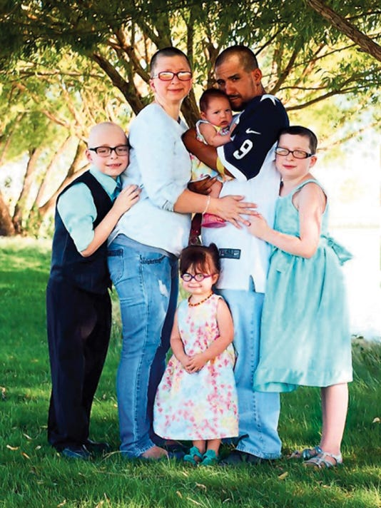"""Courtesy Photo The Alex's Lemonade Stand Foundation chose the the family of Peter """"Pete"""" Fox as the Hero Family State Representative for New Mexico. Pete was eight year's old when he was taken by cancer. The ALSF is a nonprofit organization dedicated to finding childhood cancer cures and spreading awareness. Pictured is the family, Hector Mendoza, Laci Rost, Madison Fox, the late Peter Fox, Mia Mendoza, and Hannah Mendoza."""