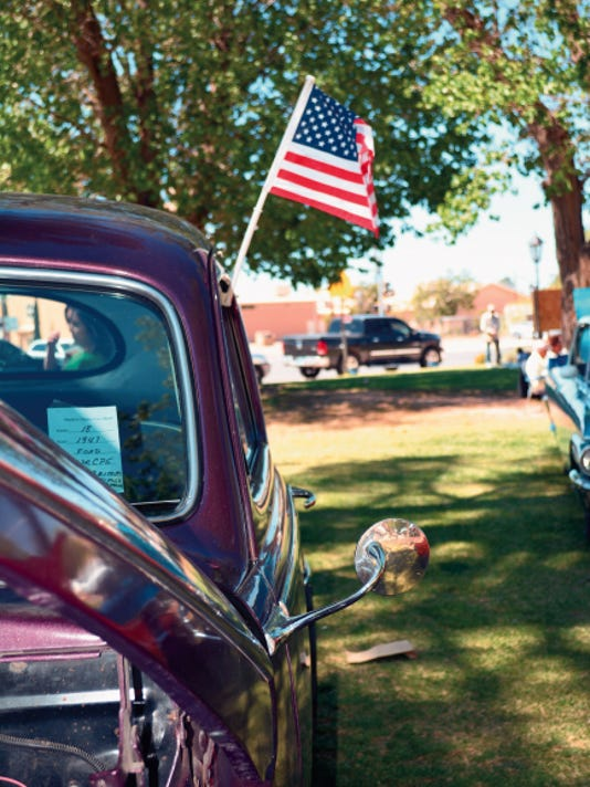Elena Ruiz - Headlight Photo   An American-made vehicle proudly displays the American Flag during the 2015 Smok'n Oldies Classic Car Show on Saturday.