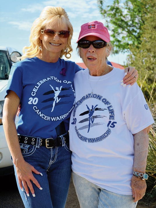 Natasha Pena, left, and Mary Lou Cameron stopped for the photo opportunity during the Celebration of Life Cancer Walk Saturday at Voiers' Park.
