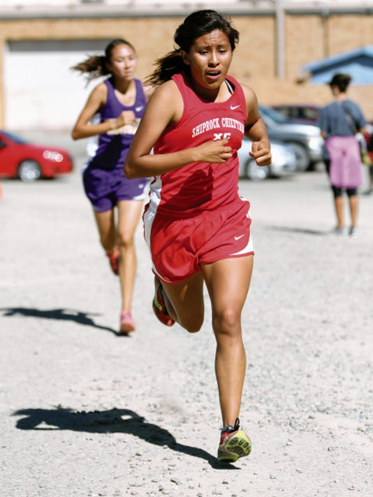 Shiprock's Lacey Howe leads LaKyla Yazzie of Kirtland Central into the final leg of the Shiprock Invitational on Saturday. Howe placed third with the time of 19:56.04, and Yazzie placed fourth with the time of 20:13.45.