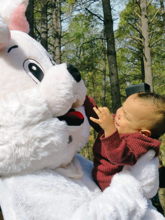 The Easter bunny is about to lose a nose by this happy toddler.
