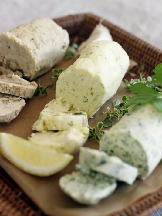 Butter compounds, from left, steak, citrus and herb. (AP Photo/Matthew Mead)