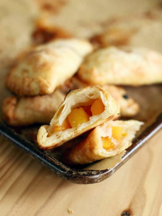 Peach Hand Pies have a light, flaky crust and a rich center.