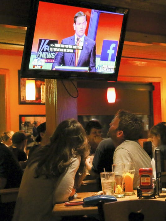 Sen. Marco Rubio of Florida is seen on a TV during the GOP debate Thursday night.