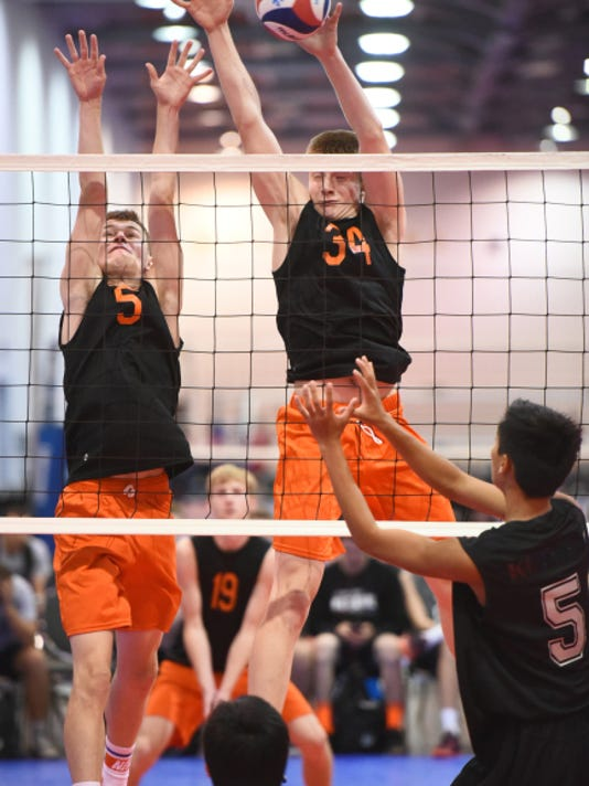 York Suburban's Kaleb Ansell (5) and Jack Schultz (34) reach up for a block against Hawaiian club team KU'IKAHI on July 3 at the the USA Volleyball Boys' Junior National Championships in Columbus, Ohio.