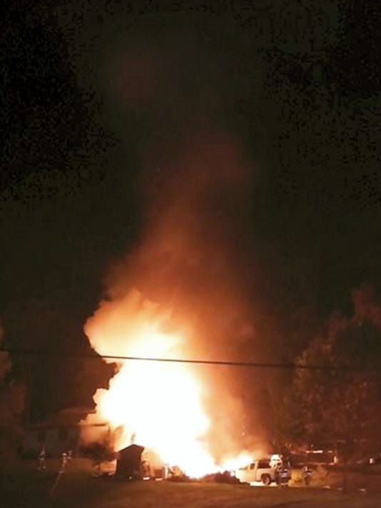 Flames engulf a house at 2228 Grace Ave., Swatara Township, early Monday morning. The house was destroyed.