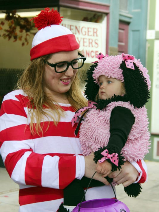 Corrine Strine and her daughter Aliah walk in their costumes during the Trick-or-Treat on Main Street event in downtown Chambersburg on Saturday.
