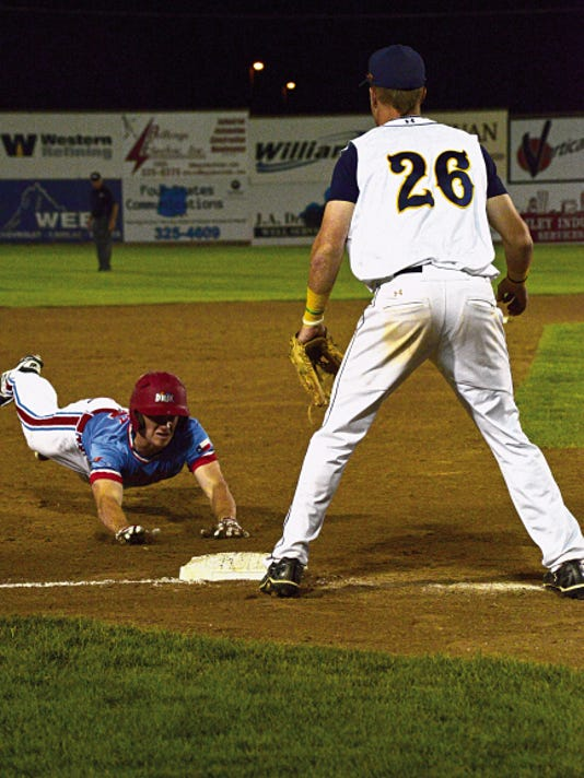 D-BAT Gallegos' Cody Farhat slides safely into third on Friday in the championship game of the Connie Mack World Series against the Midland Redskins at Ricketts Park in Farmington.