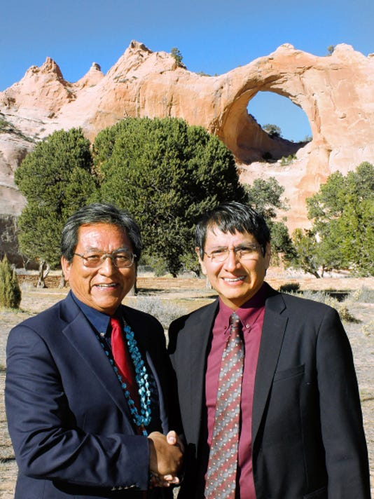 Navajo Nation presidential candidate Russell Begaye, left, and his running mate Jonathan Nez pose for a photo Wednesday in Window Rock, Ariz.