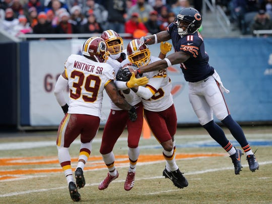 Washington Redskins cornerback Bashaud Breeland (26) intercepts a pass intended for Chicago Bears wide receiver Josh Bellamy (11) as Donte Whitner Sr. and Josh Norman (24) watch during the first half of an NFL football game, Saturday, Dec. 24, 2016, in Chicago. (AP Photo/Charles Rex Arbogast)