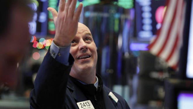 Specialist John O'Hara gestures as he looks at the Dow Jones industrial average before the closing bell on the floor of the New York Stock Exchange, Wednesday, Dec. 26, 2018. The Dow closed up more than 1,000 points in best day for Wall Street in 10 years as stocks rally back from Christmas Eve beating.