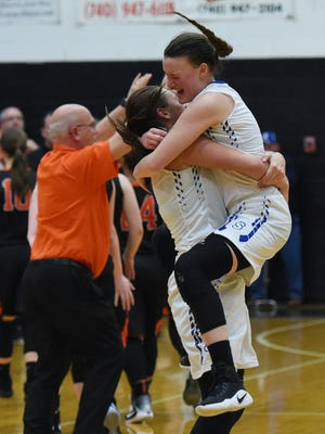 Southeastern defeated Ironton 61-55 in triple overtime Thursday in Waverly. After the win, senior Audrie Wheeler jumped into teammate Rachel Collins' arms in jubilation.