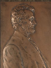 "VIctor D. Brenner's ""Bronze relief plaque that serves as the inspiration for the copper penny, 1907,"" is up for auction in ""The Harold Holzer Collection of Lincolniana"" on Sept. 27 at Swann Galleries."