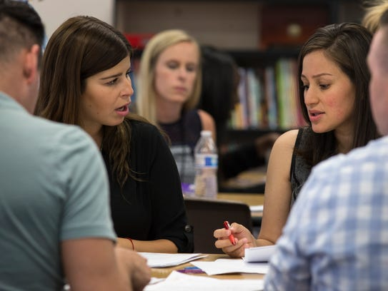 Erin Olitzky (left) and Erica Martinez talk during