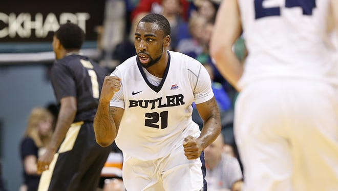 Butler Bulldogs forward Roosevelt Jones (21) celebrates after making a shot against the Purdue Boilermakers during the Crossroads Classic at Bankers Life Fieldhouse on Dec. 19, 2015.