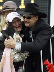 Chip Woolley, right, congratulates jockey Calvin Borel after winning the 2009 Kentucky Derby.