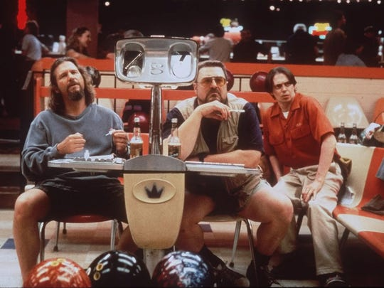 "(From left) Jeff Bridges, John Goodman and Steve Buscemi appear in a scene from the motion picture ""The Big Lebowski."""