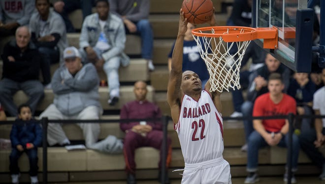 Ballard's Kereion Douglas dunks during the Bruins' game at the King of the Bluegrass Holiday Classic in Fairdale, Ky, Tuesday, Dec. 12, 2017