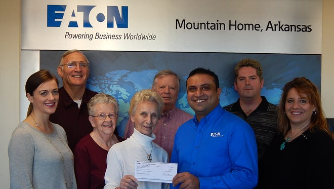Eaton Aeroquip employees presented Mountain Home Food Basket with a $20,000 grant allowing improvements to the facility. Shown are from left, Margaret Guillemette (Eaton), Bill Lucas (MHFB), Kay Owens (MHFB), Bonnie Ratzel (MHFB), George Illian (MHFB), Purushi Doddanna (Eaton), Brad Gregg (Eaton) and Tracy Rosson (Eaton).