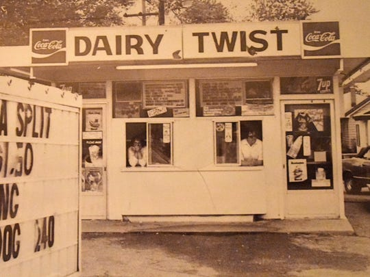 Marie (Mickey) and Frank Toarmina in the windows of Mickey's Dairy Twist founded 50 years ago.