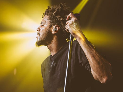 Artist J Cole,  performs on stage songs from latest