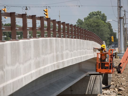 Construction crews continue work on the East Jackson Street bridge Monday. Traffic on the bridge has been limited to one lane in both directions since early August 2017. Traffic is scheduled to shift from the north lane to the newly rebuilt south lane as of Tuesday, July 10, according to INDOT.