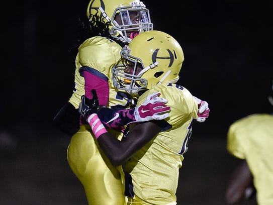 Hillsboro's Tre Dickerson (right)