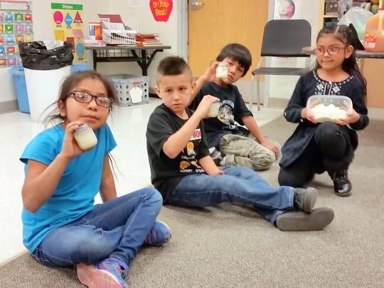 Faithlynn Torres, AJ Starr, Jr. Mendez shake baby food