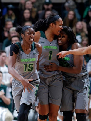 Michigan State's Victoria Gaines, left, Sidney Cooks, center, Nia Hollie celebrate a play against Indiana Saturday, Jan. 20, 2018, in East Lansing, Mich. Michigan State fell 69-65.