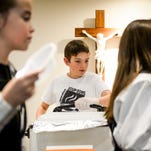 Ben Kelly serves soup at Operation Soup Bowl, a bread and soup lunch to help fight poverty in the community, Wednesday, March 4, 2015, in Fort Collins, CO. The annual event was put on by eighth-graders at Saint Joseph Catholic School.