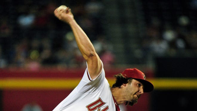 Arizona Diamondbacks pitcher Mike Bolsinger throws during the fifth inning against the New York Mets on April 14, 2014, at Chase Field.