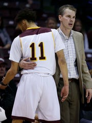 A dejected Jarred Dixon leaves in the final minutes of the loss against Illinois State University as coach Lusk offers encouragement at JQH Arena in Springfield on January 30, 2018.