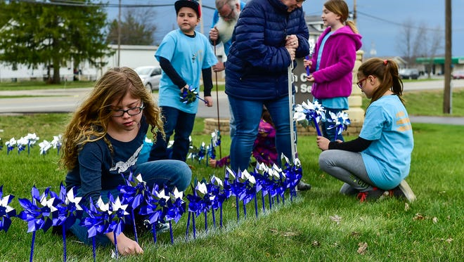 More than 25 children planted 753 pinwheels Thursday in front of the Marion County Children Services building. The pinwheels represent the number of child safety assessments performed by agency caseworkers in 2016.