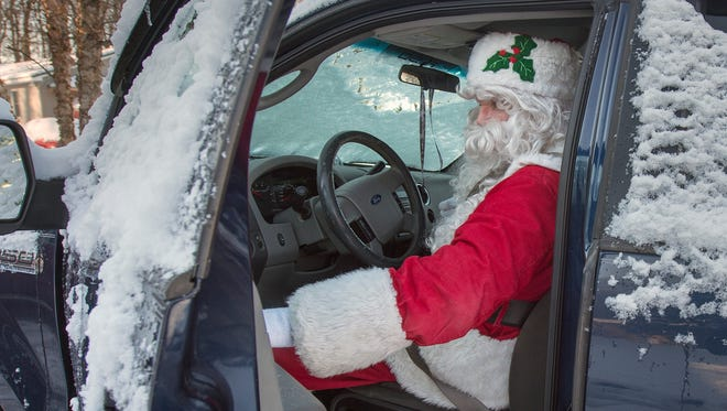 Richard Gibbs climbs into a snow covered F-150 leaving his home in Hopewell Township for an appearance at the Family Tree Farm, just south of Red Lion earlier this month. If forecasts hold, there is a pretty good chance that Santa will track in some snow as he works across central Pa. this holiday weekend.