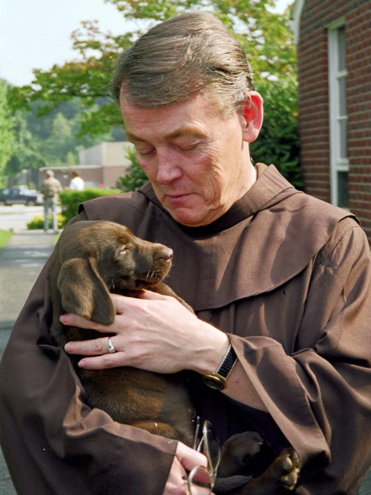 636676097361222553-Father-Bill-and-Puppy-Liam-01.jpg