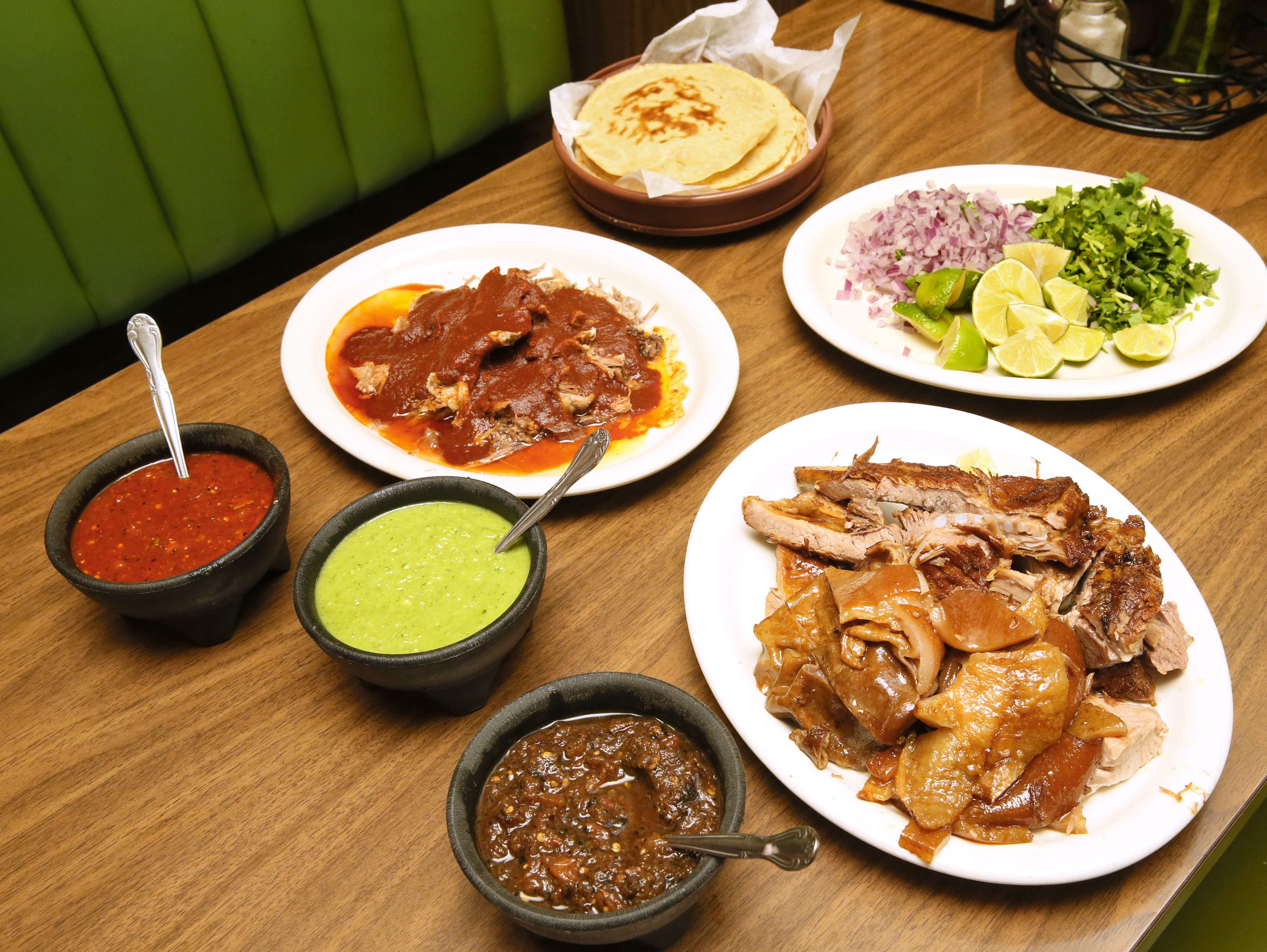 Group serving portions of the salsas (from back to