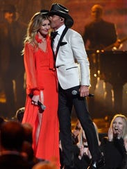 Tim McGraw kisses his wife, Faith Hill, after their