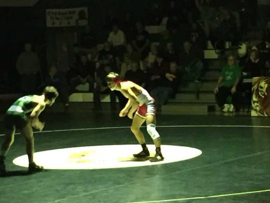 Joe Sacco (left) wrestles Jake Benner