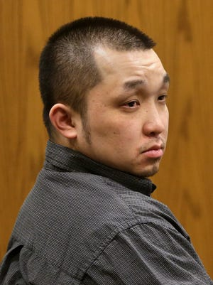 Chong Leng Lee, 30, during his trial in Outagamie County Circuit Court Monday, March 7, 2016, in Appleton, Wis. Lee is charged with first-degree intentional homicide with a dangerous weapon, soliciting perjury and four counts of being party to the crime of witness intimidation in the 2013 shooting death of Joshua Richards, 25, of Green Bay at the now-closed Luna Lounge nightclub in Appleton, Wis. Danny Damiani/USA TODAY NETWORK-Wisconsin