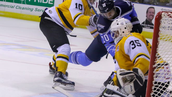 Pensacola's Mitchell Vandergunst (20) gets shoved behind by Mississippi's Devin Mantha (10) as the RiverKings goalie Tyler Green (35) stops the puck during the first home game of the season at the Pensacola Bay Center on Friday, October 27, 2017. The Ice Flyers shut out Mississippi 2-0 and have won two straight games to start the season 2-0.