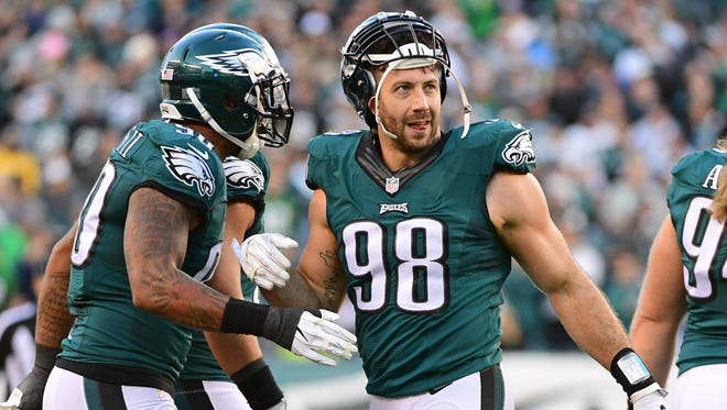 Eagles defensive end Connor Barwin (98) celebrates with  defensive end Marcus Smith (90) during a game earlier this year against Atlanta.